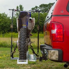 Side view of dirt bike secured to hitch motorcycle carrier
