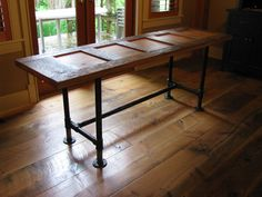 Custom made pipe frame tables and desks by Wesley Ellen Design & Millwork.  www.wesleyellen.ca