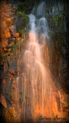 Sunlight & Shade highlight the beauty of a cliffside waterfall.  Bay of Fundy, Nova Scotia