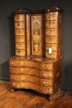 """Baroque Elaborately Inlaid Walnut Cabinet. German, c. 1750, attributed to Johann Georg Wahl, in three parts. Apx. 6'10""""h x 46-1/2""""w x 26-1/2""""d Provenance: Property sold for the benefit of the Newark Museum Acquisition Endowment."""