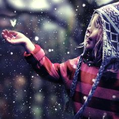 Catching snow flakes.