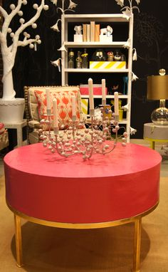 Add a pop of color with this pink circular coffee table on gold base from #Stray Dog Imports Suites at Mkt Sq G7025 #hpmkt #lisamendedesign