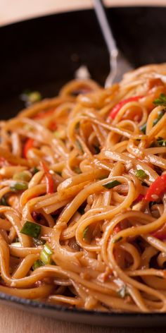 Easy Thai Noodles With Peanut Sauce is a spicy Thai noodle dish. I made it with sweet and spicy peanut sauce. This super quick noodle recipe calls for colorful veggies, peanut butter, and soy sauce. Spicy Peanut Noodles, Spicy Thai Noodles, Spicy Peanut Sauce, Peanut Butter, Asian Noodle Recipes, Asian Recipes, Buttered Noodles, Chili Sauce, Linguine