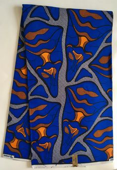 A personal favorite from my Etsy shop https://www.etsy.com/listing/523371919/african-print-fabric-ankara-blue-orange