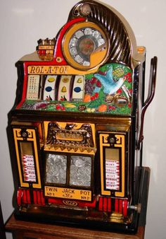 Always wanted a real antique slot machine...some day.