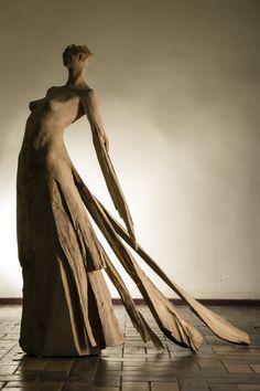 wooden sculpture of woman 1,7m height