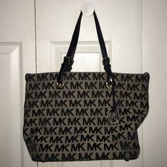Michael Kors Signature Tote Perfect condition on the outside. Very few spots on the inside. Michael Kors Bags Totes