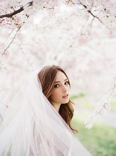 Beautiful bride with cherry blossoms. Absolutely stunning. I would love a photo like this.