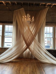 Party Tables fabric, installed by Get Lit, create an elegant backdrop for our Murano crystal chandelier, and a wedding ceremony.  Venue: The Stockroom, Raleigh