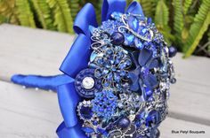 Blue Brooch Bouquet - This brooch bouquet features new and vintage navy and royal blue brooches. The bouquet is finished with a blue ribbon collar and handle with white pins. You can keep and display your heirloom bouquet for ever after. Blue Wedding, Wedding Colors, Dream Wedding, Wedding Ideas, Wedding Inspiration, Wedding Decor, Wedding Brooch Bouquets, Flower Bouquet Wedding, Vase Deco