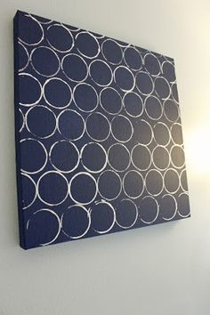 Canvas, paint and a toilet paper roll.  Instant wall art! Add some pictures to fit in the circles and it would be perfect!