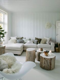 great living room set up. I love the stump tables.