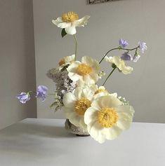 Understated floral arrangement with purple and yellow flowers. My Flower, Flower Art, Beautiful Flowers, Deco Floral, Arte Floral, Bonsai Plante, Plants Are Friends, No Rain, Flower Aesthetic
