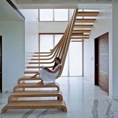 Simplistic entrance hall with wooden stairs #entrance #entrancehall #wood #stairs #design #architecture #archilovers