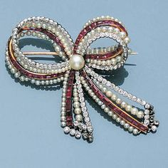 : An Edwardian ruby, diamond and pearl brooch,