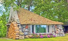 """Picture yourself staying in a whimsical Hobbit-themed cottage overlooking beautiful Lake Michigan. This vacation rental accommodates up to six people, children are welcome, and it's located just two blocks from the Northern Michigan village of Charlevoix. The best part? Rates start at just $125 a night. Three-night minimum-stay required. (From: 14 Spectacular """"Hobbit Houses"""" You Can Actually Stay In)"""