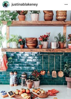 Teal subway backsplash + natural wood shelves + potted plants = Heaven!