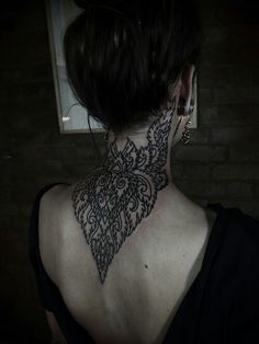 Back of the neck tattoo.