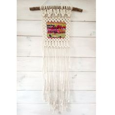 This macramé wall hanging features a picturesque square of reclaimed sari silk ribbon and handspun yarn that is framed by the natural white cotton rope. Magenta, cranberry, mustard yellow and pear green are just a few of the colors woven into this macramé weaving. Woven onto a crepe myrtle branch this macramé weaving will warm any home during the winter season!  • Macramé Wall Hanging in Fall Colors • Materials: Reclaimed Sari Silk Ribbon, Handspun Yarn, Natural White Cotton Rope, Crepe…