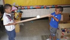 Math or Science- Provide a ramp-building material and a ball.  Allow 2 children to manipulate either side of it to move the ball back and forth.