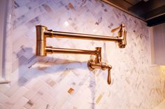 Calcutta Marble Herringbone Backsplash With A Brass Pot Filler Casiewebbdesigns Ketteringham Builders
