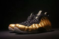Nike Air Foamposite One Metallic Gold Metallic Gold Black 314996-700  This Nike Air Foamposite One is dressed in a Black upper with a Metallic Gold Foam shell overlay, Black carbon fiber, Metallic Gold Nike Swoosh branding sitting atop an icy translucent outsole.  Tags: Nike Air Foamposite One Model: AIRFOAMPOSITE-314996-700 5 Units in Stock Manufactured by: NIKEAIRFOAMPOSITE Black Gold, Metallic Gold, Nike Gold, Foam Posites, Carbon Black, Nike Basketball Shoes, Wholesale Shoes, Cheap Shoes, Shoe Shop