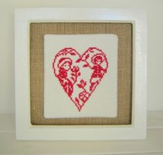 Red Hand Stitched Boy, Girl and Heart Framed Embroidery Picture Winter Nursery Decor,winter gifts,handmade,hand stitched, childrens decor, childrens gifts, baby gifts,sister gifts,brother gifts,framed hearts, christmas gifts,good quality gifts, everlasting christmas, Hand stitched cross stitch boy and girl floral heart embroidery which has been mounted onto vintage cotton fabric. Glass cover. Measurements approx 7.5 x 7.5 inches (20cm x 20cm) One of a kind