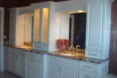 A beautiful bathroom with his and hers sinks. and plenty of storage. Design & installed by Royal Palm closet design and fine cabinetry 239-768-2391