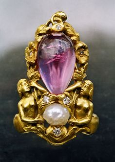 F. WALTER LAWRENCE 1864-1929 Superb Mermaid Ring Gold Pink Tourmaline Pearl Diamond H: 3.2 cm (1.26 in) W: 2 cm (0.79 in) Marks: 'F. LAWR.' American, c.1900 Fitted Case Literature: cf. Imperishable Beauty, Art Nouveau Jewelry, Yvonne J. Markowitz & Elyse Zorn Karlin, Museum of Fine Arts, Boston, 2008, p. 112 & 148 Ref: 3714