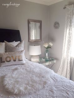 Lightweight white curtains with a delicate silver pattern add to the soft feel in this bedroom. All available at HomeGoods. Sponsored Pin.