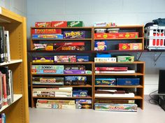 Inexpensive shoe racks from target to organize board games.
