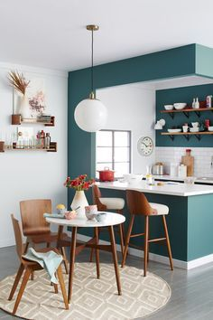 How to Style a Small Space...I love the white walls with the punch of color! The simple wood furniture is great too.