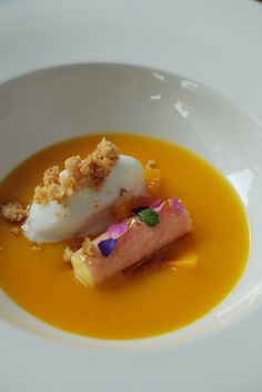 chilled mango soup with grapefruit , coconut ice-cream ,lemon and passionfruit cremeux rolled in the Japanese traditional pastry.