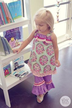 cute. Love the bookshelf/books as well!