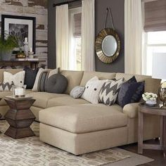 A complex solution, successfully combining the natural warmth of beige and the cool tones of gray used in this room. Could have chosen to put on my 'gray' board, but so far have felt okay with it here. Sutton U-Shaped Sectional by Bassett Furniture.  by kutlu.ersoz