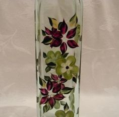 Oil decanter hand painted with magenta and olive color flowers with leaves of dark green and soft yellow