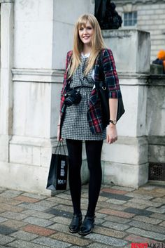 Student Francesca Auld shows off an oversize plaid blazer from River Island paired with a printed Topshop dress—plus the the most functional accessory of all: a classic camera.