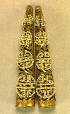 Qing dynasty long life gold and pearl fingernail guards, (probably used by Empress Dowager Cixi), Forbidden City collection.