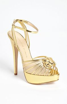 Charlotte Olympia 'Croissant' Pump. Golden leather spins opulent drama across a decadent pump, playfully topped with a nod to the French foodie.