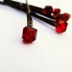 Oxblood bobby pins - see more on http://themerrybride.org/2014/05/03/oxblood-red-wedding/
