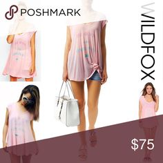 """WILDFOX COVERUP Tunic Dress WILDFOX COVERUP Tunic Dress My Happy Place Mini 💟NEW WITH TAGS💟 RETAIL: $88 'The Beach is my Happy Place' * Deep scoop neck, & an oversized/relaxed fit   * Incredibly soft, comfortable, lightweight, ribbed T-Shirt fabric * Graphic detail front; A subtly 'washed' look * About 28"""" L   * Cap sleeves   Fabric:Rayon;Made in the USA Color:Pink Item: Pastel blush fuschia lilac # Shirt dress 🚫No Trades🚫 ✅ Offers Considered*/Bundle Discounts✅  *Please use the 'offer'…"""