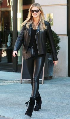 Kate Upton in leather pants, ankle boots, and leather jacket
