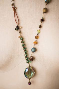 Unique gemstone and blue/green crystal focal necklace is handcrafted on antique brass