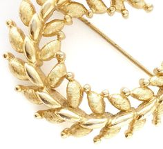 This pretty detailed gold leaf brooch is available in my shop and would be a lovely gift idea for a vintage lovers especially they fancy 50s Mad men - mid century fashion. Brushed gold tone metal this well made brooch is sign by Monet c.1950s. measures 2 inches by 1 1/2 inches (5cm x 4cm) . excellent condition.  Thank you for looking :) Browse more of Pitti Vintages lovely jewelry: https://www.etsy.com/listing/224924779/gold-filigree-mushroom-brooch-60s?ref=shop_home_active_1 *All sales are…