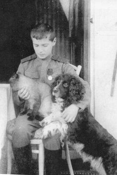 Alexei with a pet cat and his Spaniel, Joy. Joy was given to Alexei around the beginning of the Great War. Joy went with Alexei and the rest of the family into exile. Unlike her master, she survived the massacre at Ekaterinburg.