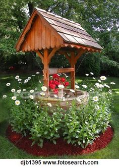 Wishing well, made of cedar wood with white flowers around in green, manicured garden lawn. Lawn And Garden, Garden Paths, Wishing Well Garden, Lawn Edging, Garden Projects, Amazing Gardens, Backyard Landscaping, Landscaping Ideas, White Flowers