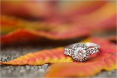 Halo engagement ring with a round center stone, engagement ring, diamonds on the side of a halo ring