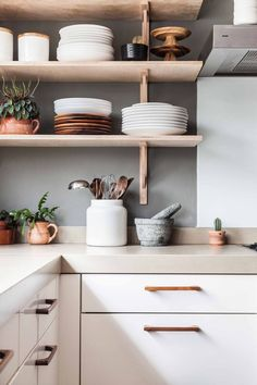 Kitchen - open shelving - kitchen wares on display. Homely, spacious kitchen storage with earthenware pots. Bright, modern, contemporary living. Good space-saving solutions for modern, airy, bright kitchens.