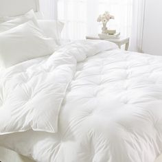High quality Down Comforters, Feather Beds and Down Pillows at discount prices >> Down Comforters --> www.xtracomfort.com