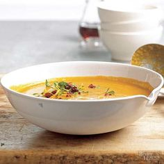Pumpkin spice and curry make a sweet, kicky statement in this cozy autumn soup. Canned pumpkin keeps things extra creamy, while a citrus-cranberry sprinkle tops it off in a sweet way./